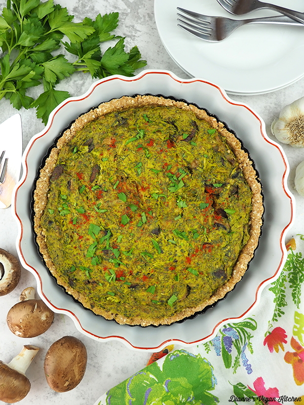 quiche in baking dish with plates