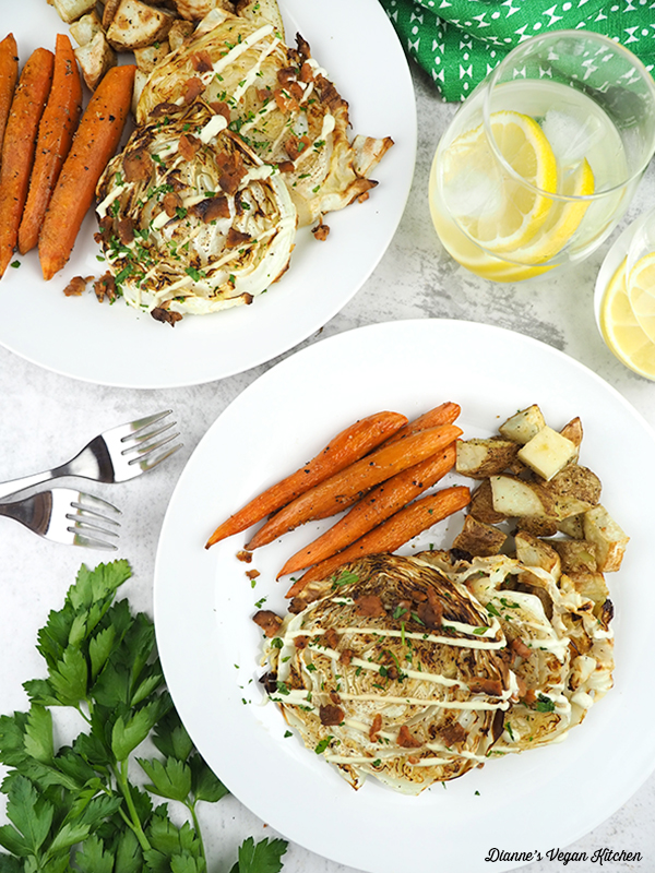cabbage steaks on plate with potatoes and carrots overhead