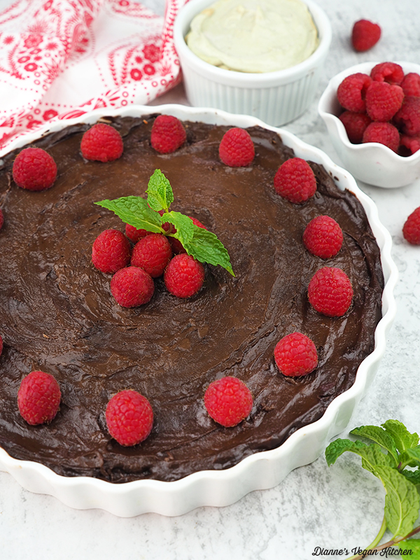 Vegan Chocolate Mousse Pie with raspberries and cashew cream