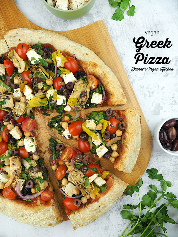 vegan greek pizza on paddle with text overlay