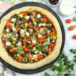 Vegan Greek Pizza on pan