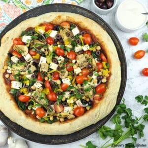 Vegan Greek Pizza on pan