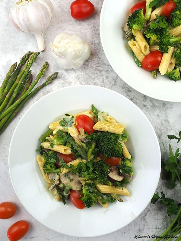 two plates of vegan pasta primavera