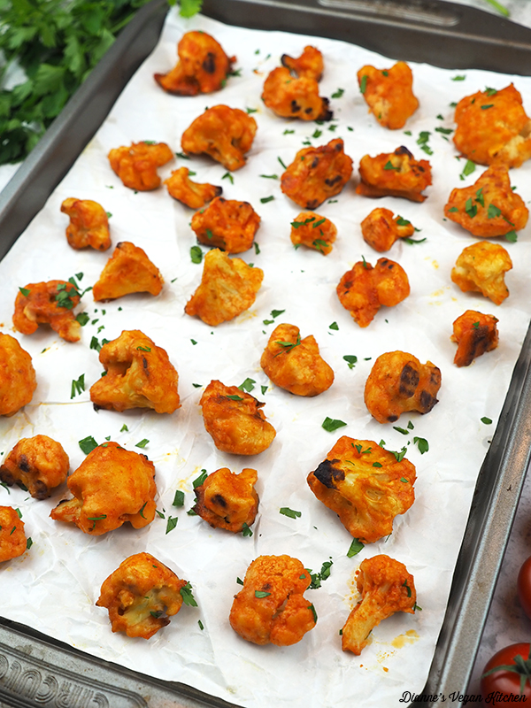 Vegan Buffalo Cauliflower Bites on baking sheet