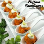 Vegan Buffalo Cauliflower Bites on spoons with text overlay