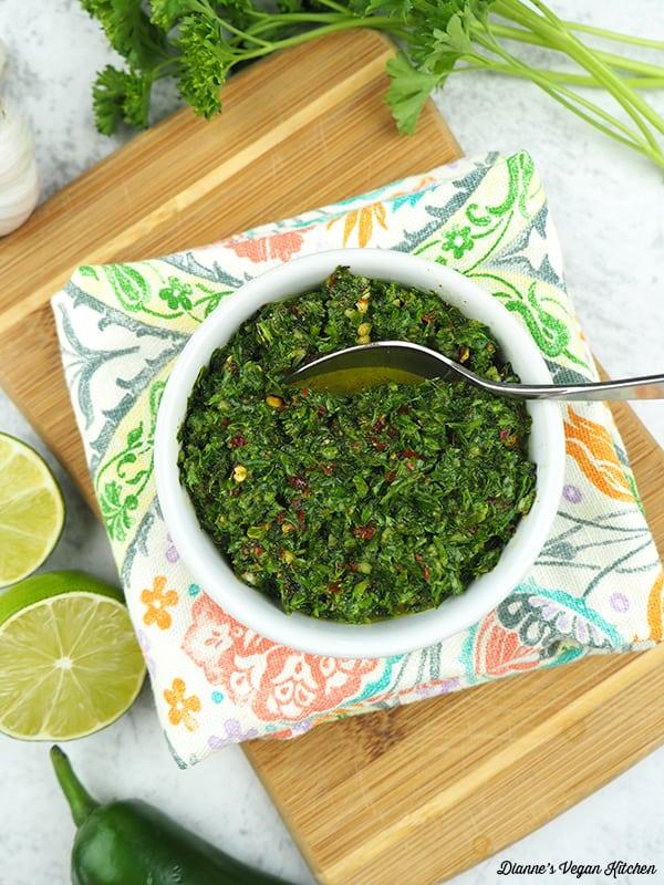 Chimichurri Sauce on cutting board with spoon