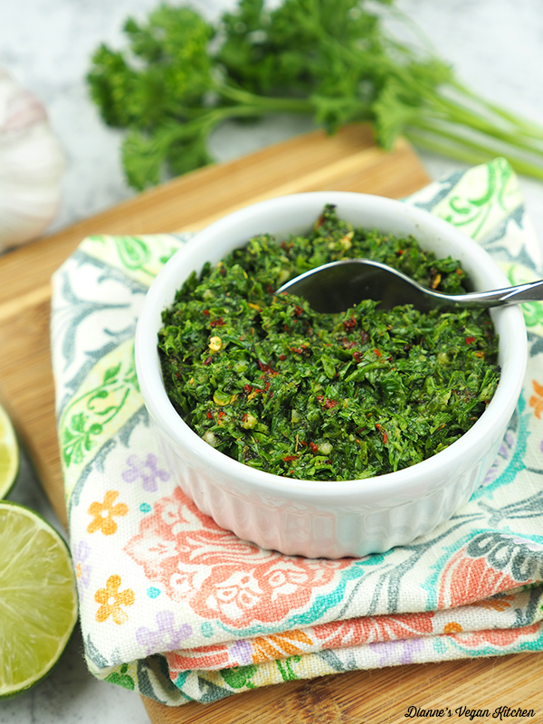 Chimichurri Sauce on wooden board with spoon