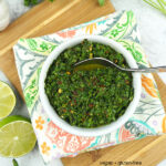 Chimichurri Sauce on wooden board with text overlay