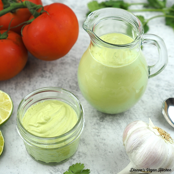 two containers of Jalapeno Lime Aioli with tomatoes and garlic