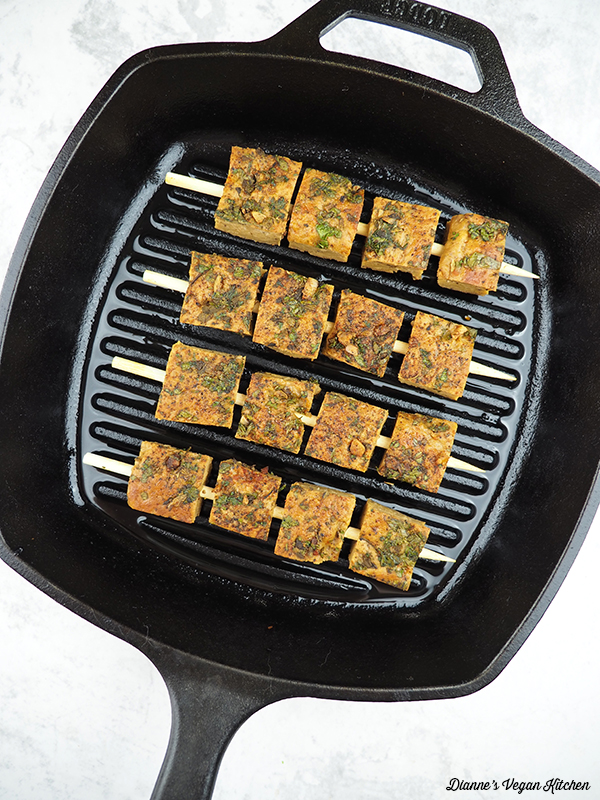 cooking skewers in grill pan