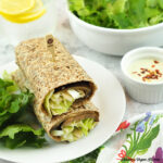 stack of eggplant wraps with salad, square