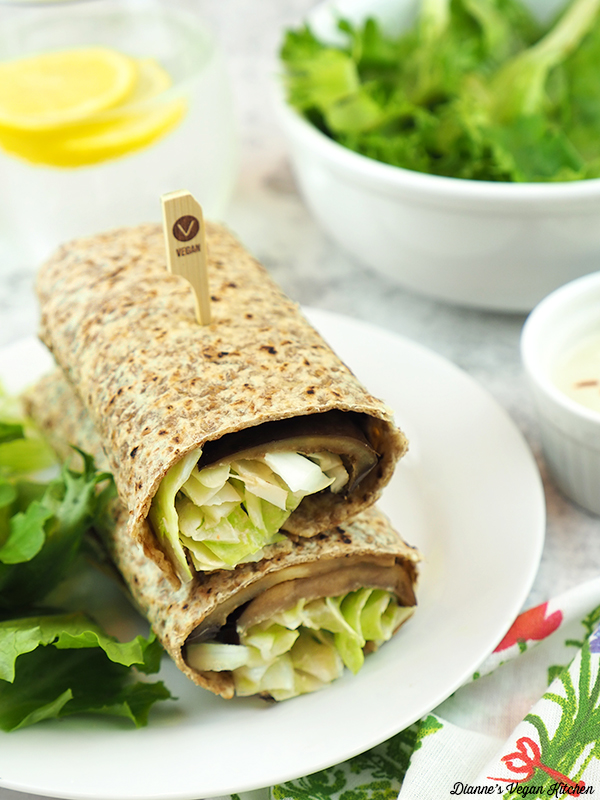 stack of eggplant wraps with lemon water and salad