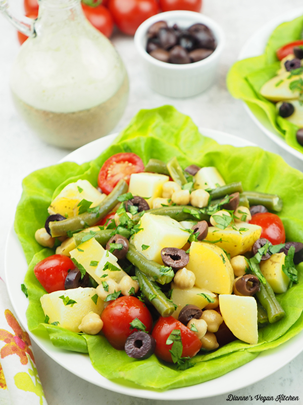 salad with dressing and olives