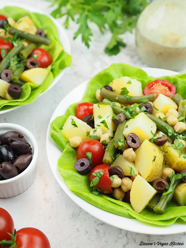vegan potato salad with olives and tomatoes