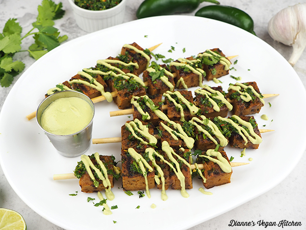 Seitan Skewers with Chimichurri and Jalapeno Lime Aioli on platter horizontal