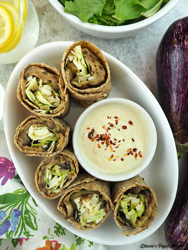 eggplant wraps in dish with tahini dressing
