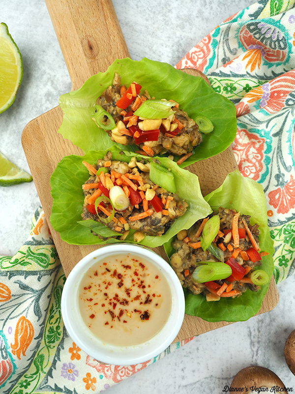 lettuce wraps on cutting board with mushrooms and lime