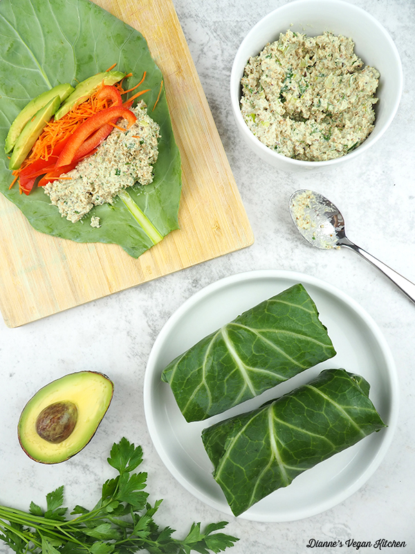 two collard wraps on a plate with one wrap being made