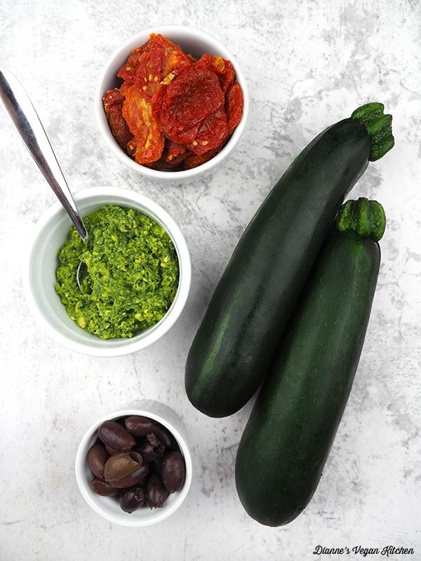 zucchini, pesto, sun-dried tomatoes, olives