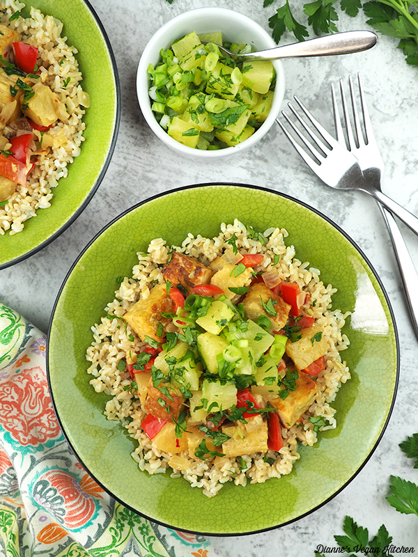 two bowls of Thai Coconut Tempeh with Pineapple Salsa overhead