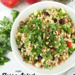 large bowl of farro salad with text overlay