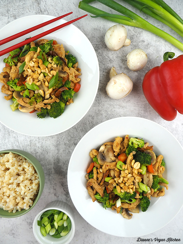 two bowls of Vegan Kung Pao Soy Curls overhead with rice, mushrooms, peppers, and scallions