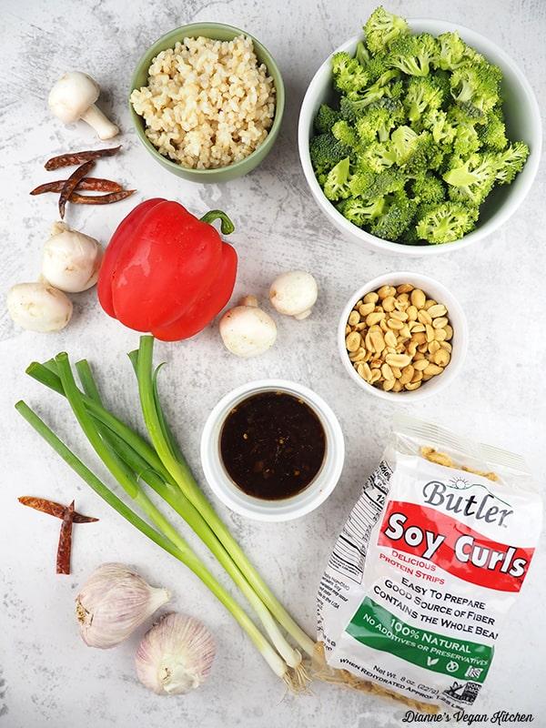 mushrooms, rice, broccoli, peanuts, soy curls, sauce, scallions, garlic, pepper