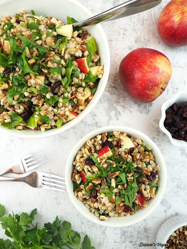 two bowls of farro salad with apples and cranberries