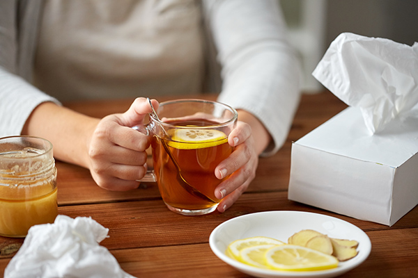 drinking tea with a tissue box