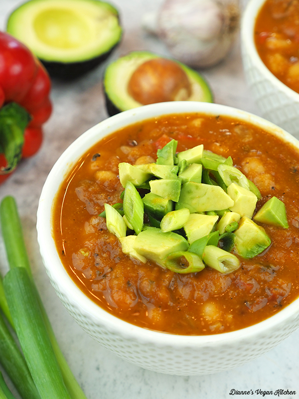close up of bowl of chili with avocados and pepper