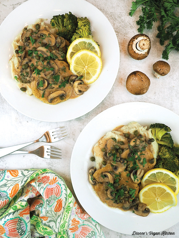 two plates of piccata overhead