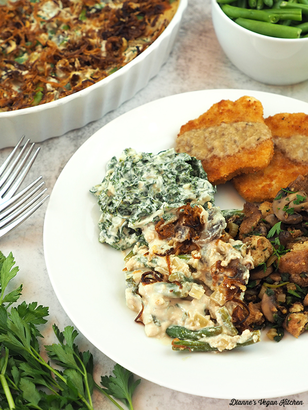 plate with turk'y patties, stuffing, casserole, and kale