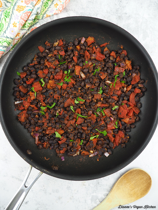 cooked beans and tomatoes in pans