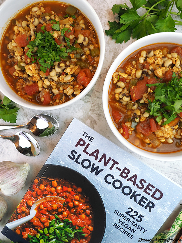 two bowls of chili with The Plant-Based Slow Cooker cookbook