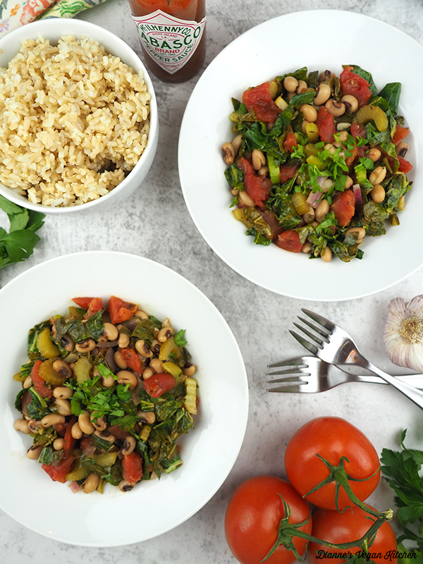 two bowls of Vegan Hoppin' John with brown rice and tomatoes