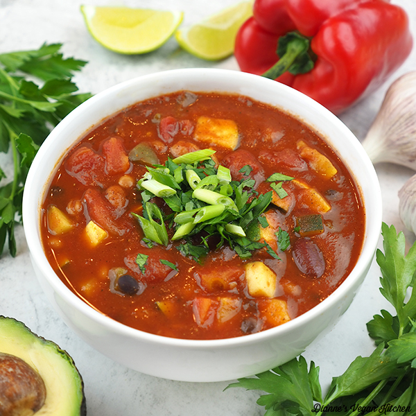 Three Bean Chili with avocado, parsley, lime, and garlic square