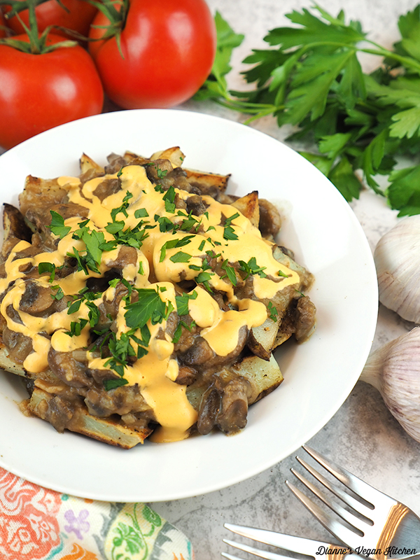 Vegan Disco Fries with tomatoes, parsley, and forks