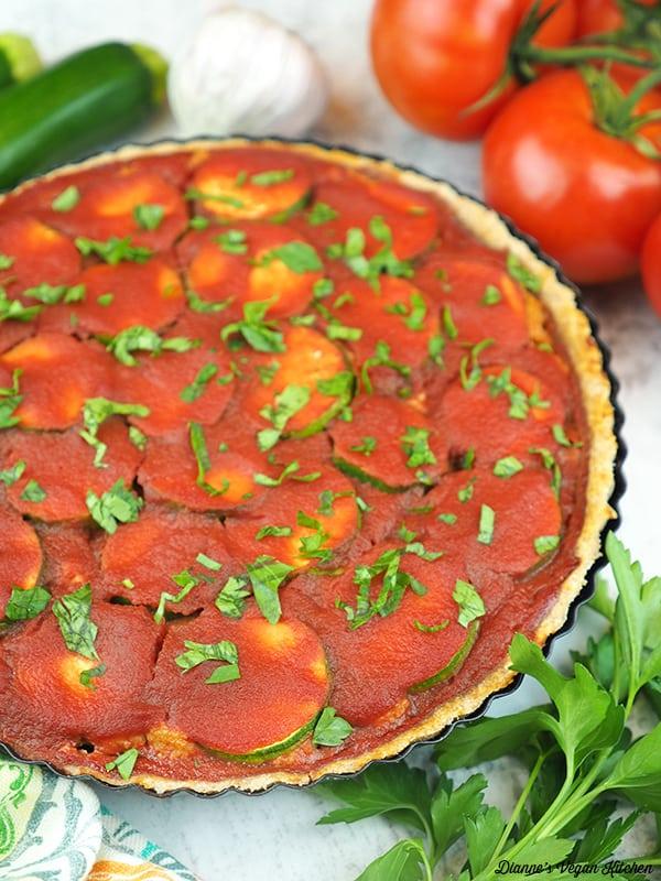 Vegan Lasagna Tart with tomatoes, garlic and zucchini