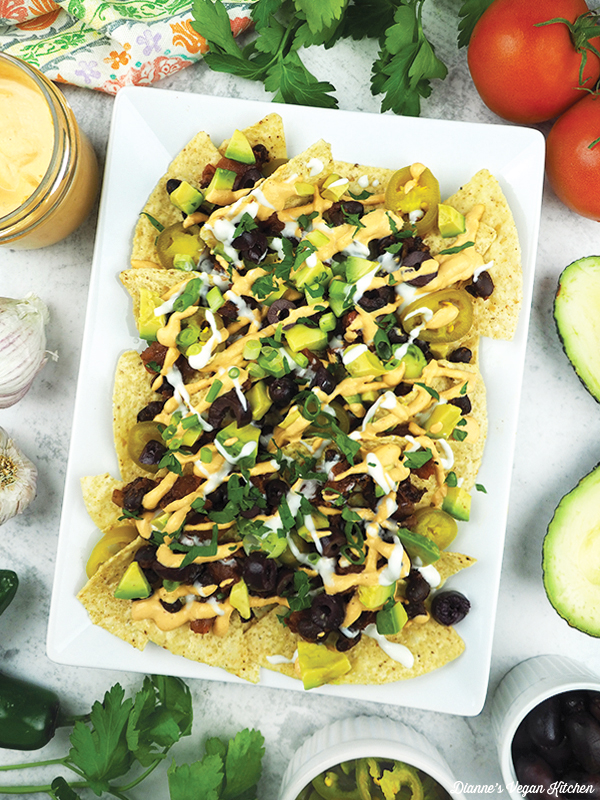 Vegan nachos with avocado, tomatoes, peppers, and garlic