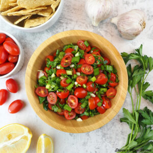Fresh Tomato Salsa square with tomatoes, garlic, chips, and lemons
