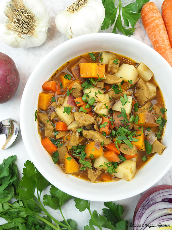 one bowl of stew with carrots, parsley, onion, garlic, and parsley