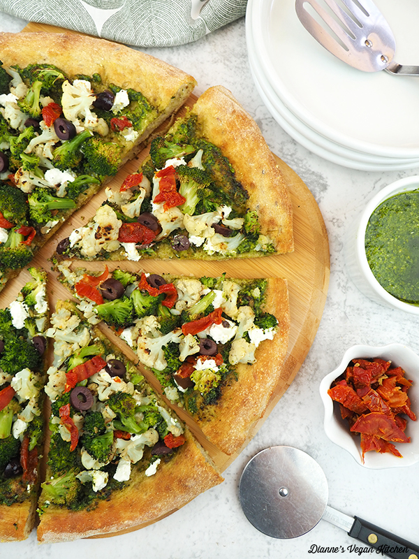 Vegan Green and White Pizza on pizza paddle