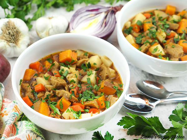 two bowls of stew with garlic and onion horizontal