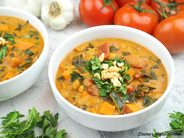 two bowls of Chickpea Peanut Stew with tomatoes horizontal