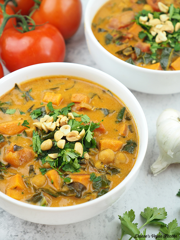 two bowls of stew with tomatoes, garlic, and parsley
