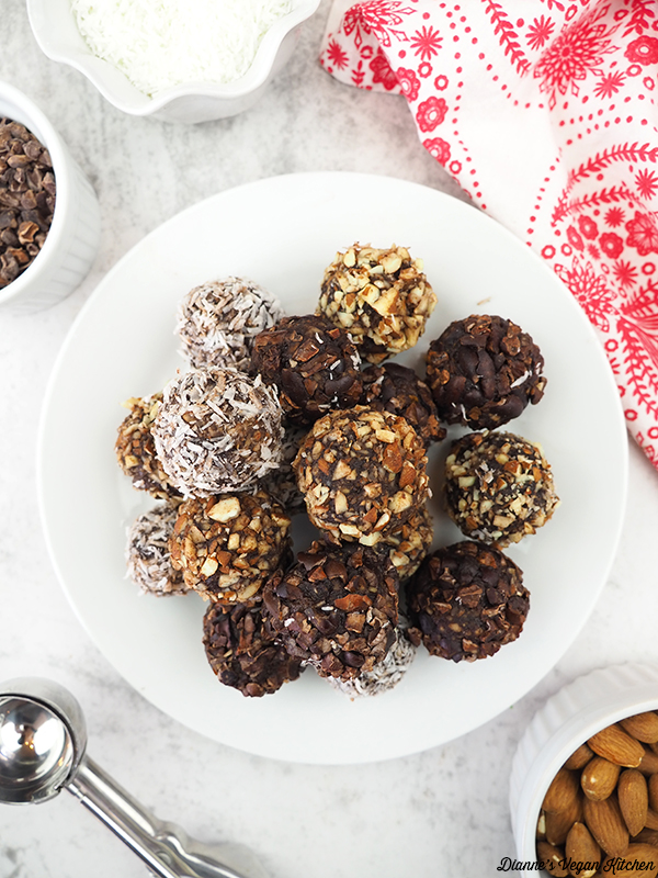 overhead of truffles with cacao nibs, almonds, and coconut