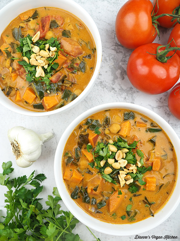 two bowls of Chickpea Peanut Stew with tomatoes, garlic, and parsley