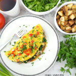 omelet overhead with tea, salad, and potatoes with text overlay