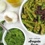 Vegan Arugula Pesto with pasta with text overlay
