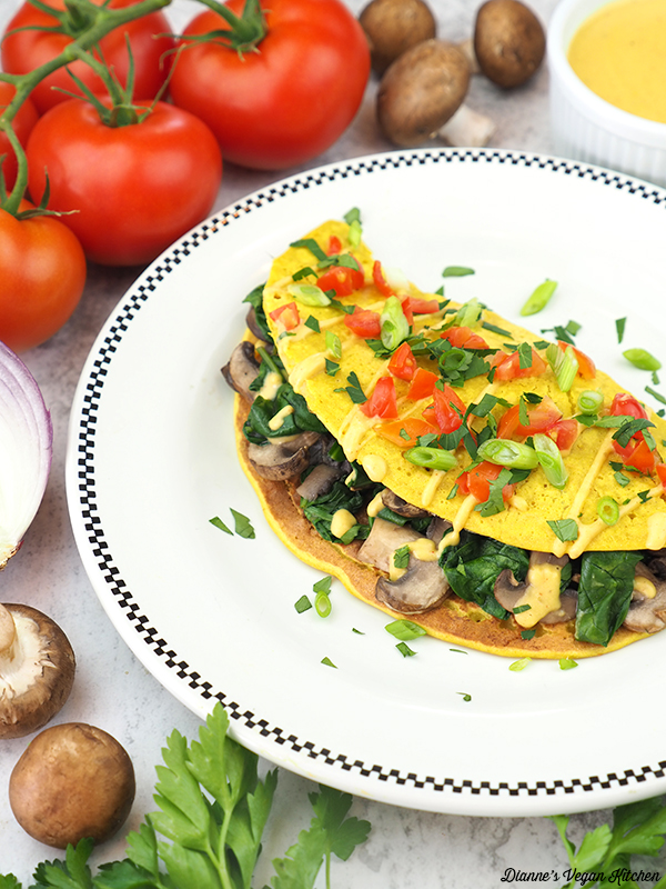 Vegan Spinach Mushroom Omelet with tomatoes, onion, and mushrooms